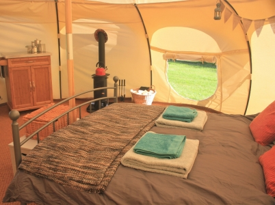 The inside of a comfortable glamping tent
