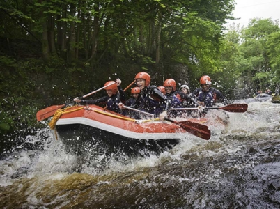 A group enjoying white water rafting on the River Tryweryn, Snowdonia National Park