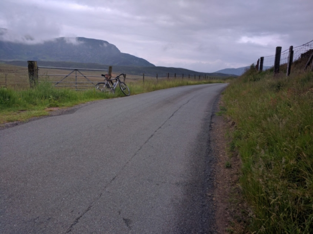 A view of Arenig Fawr shrouded in cloud with a road bike in the foreground