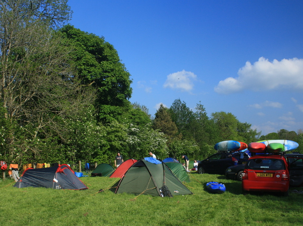 kayak group camping on the traditional camping field at Tyn Cornel campsite